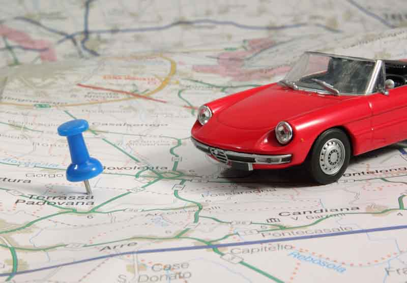 model car on paper map