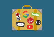 A suitcase covered with notable entertainment company logos.