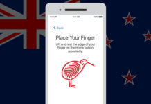The New Zealand flag faded in the background with a phone in front of it with a picture of a kiwi bird drawn like a fingerprint.