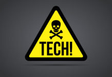 "A warning sign with a skull and crossbones and the word ""Tech""."