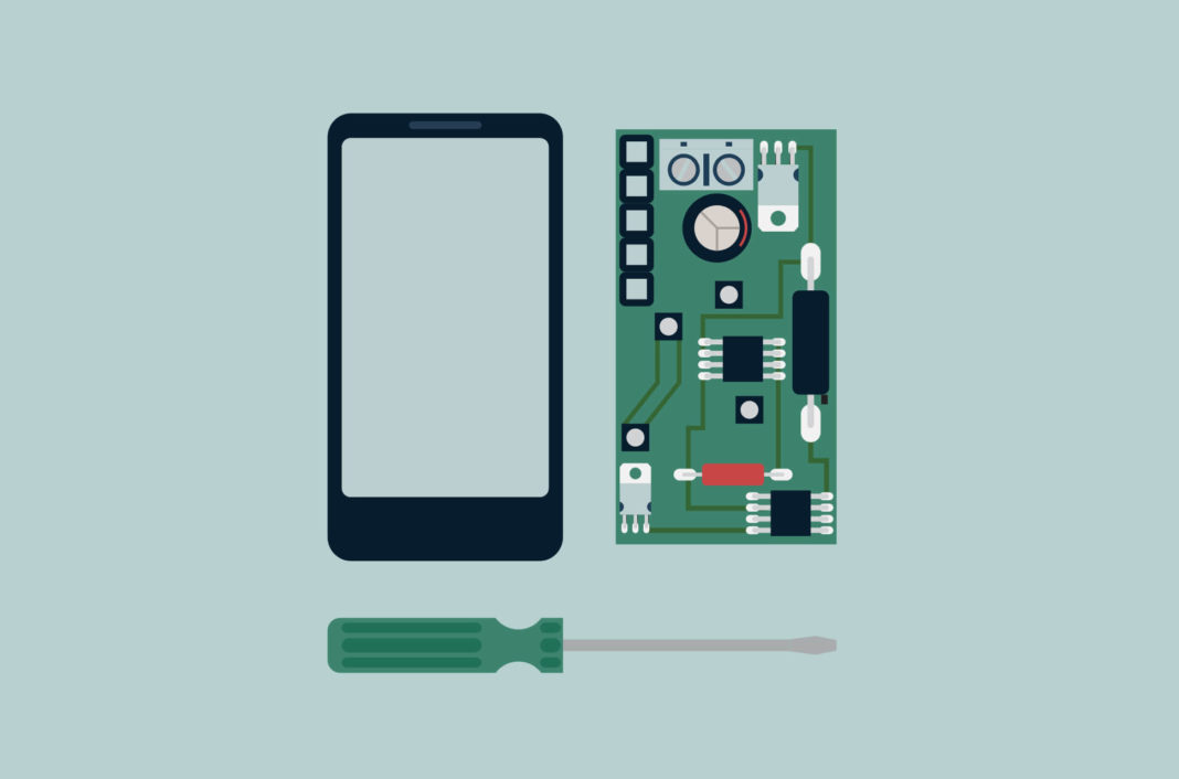 A dismantled phone and screwdriver.
