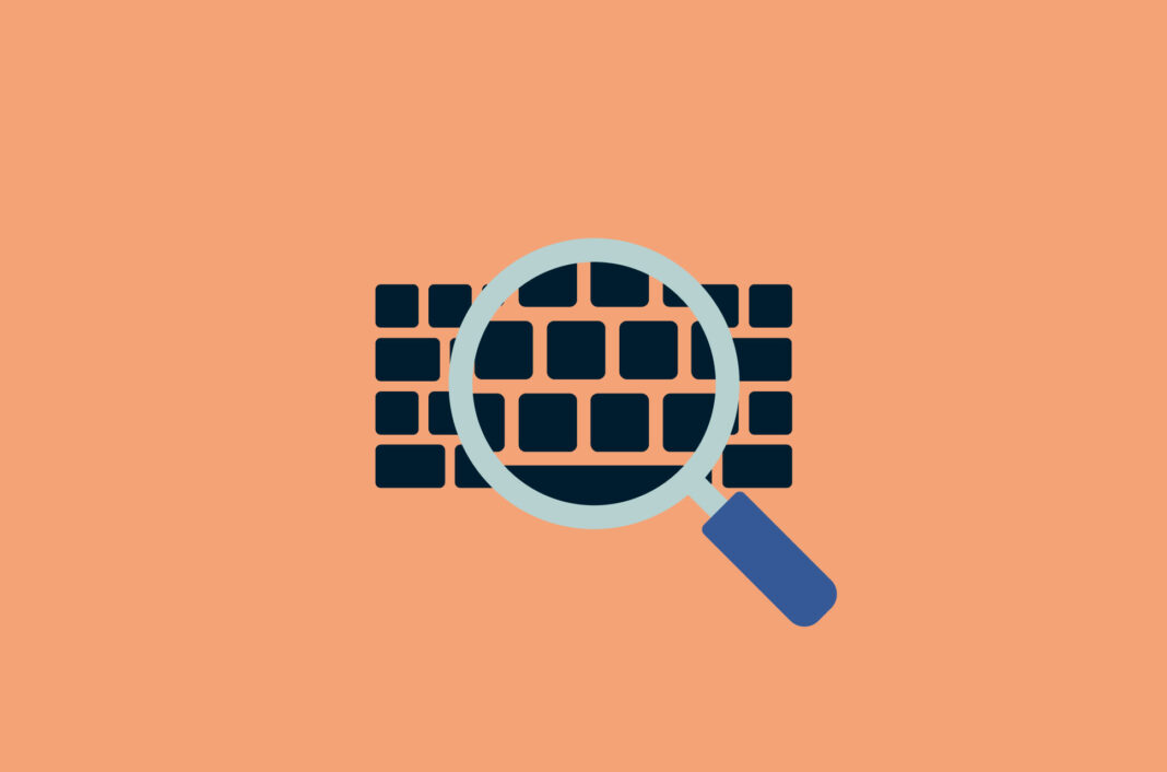 Magnifying glass over a computer keyboard.